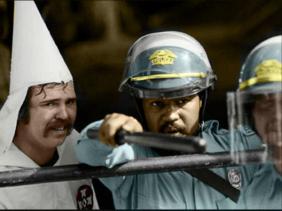 black-police-officer-helping-a-kkk-member-as-a-mob-of-protesters-were-closing-in-on-their-demonstration